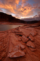 Rocky Shore of Lake Powell At Sunset